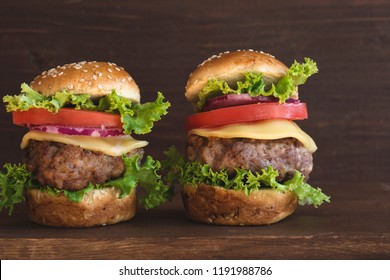 Mini burgers on wooden background