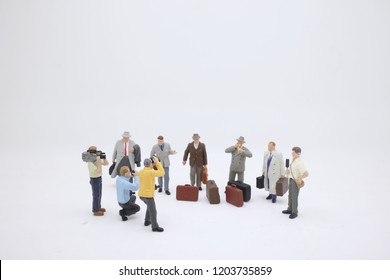 the  mini business  traveler figure standing on