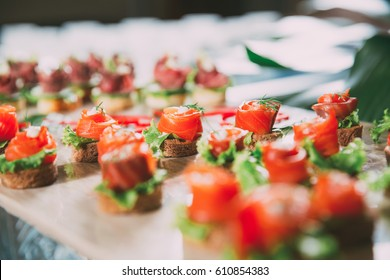 Mini Canapes with Smoked Salmon on Buffet Table
