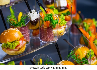 Mini canapes with vegetables, meat, cheese and seafood in plastic cups