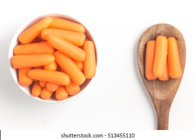 Mini Carrots Into a Bowl isolated on white background