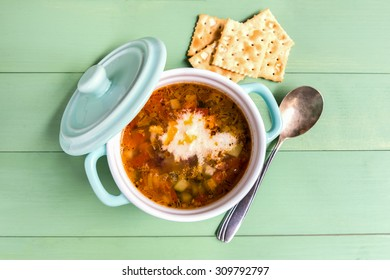 Mini casserole of minestrone soup with cracker. Above view