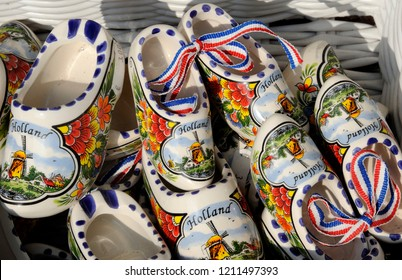 Mini ceramic wooden shoes as traditional footware from Holland for sale in a souvenir shop in Delft, Holland