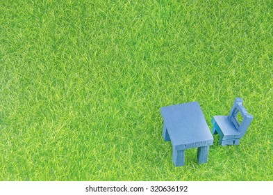 mini chair and table on a grass