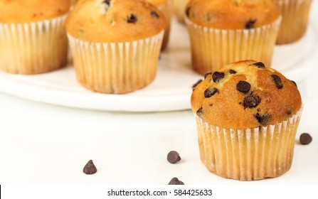 Mini chocolate chip muffins on white background, selective focus