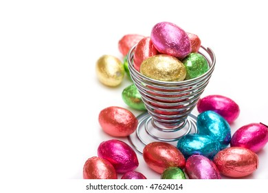 Mini chocolate eggs in wire eggcup