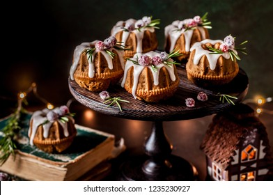 Mini Christmas Bundt Cakes Decorated with Sugared Cranberries and Rosemary