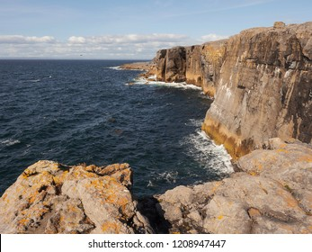 Mini cliffs, county Clare, Ireland, tourist attraction on Wild Atlantic Way, popular spot for cliffhanger training.