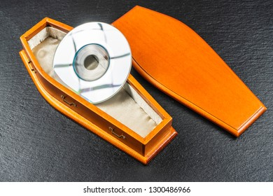 Mini compact disc or pocket compact disc in coffin.Concept.