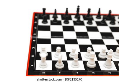 Mini compact portable chess with small figures on a white background