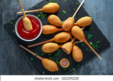 Mini Corn Dogs on stone platter with ketchup
