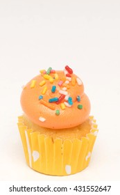 Mini cupcake on a white background. Room for text at the top.