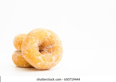 mini donuts sugar,sweet pieces of sugar doughnuts on white background, Copy space