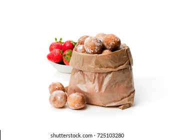Mini  doughnuts stuffed with strawberry jam in paper bag isolated on white