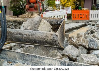 Mini excavator at road construction