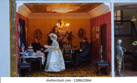 Mini figure diorama men  in the vintage dining room and maid preparing for dinner