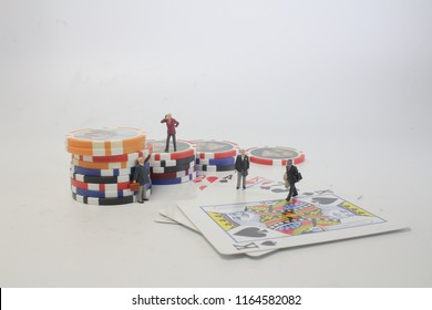 mini figure with Poker cards gambling chips