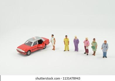 a  mini figure wait the HK taxi