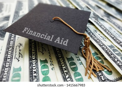 Mini Financial Aid graduation mortar board cap on money