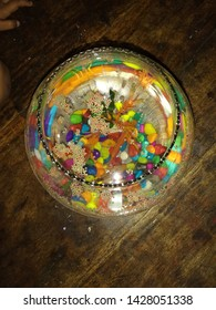 mini fish bowl and colourfull stones and trees