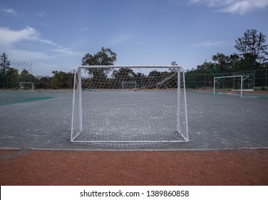 Mini football goalposts with nets and court, daylight in a school, outdoors, sky as a background
