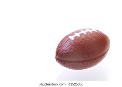 Mini football on a white background with reflection