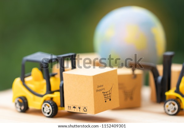 Mini forklift trucks load cardboard box with online shopping symbol with nature background and globe nearby. Logistics and transportation management ideas and Industry business commercial concept.