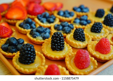 Mini fruit tartlets with fresh berry fruit and lemon curd