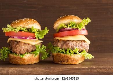 Mini hamburgers on wooden background