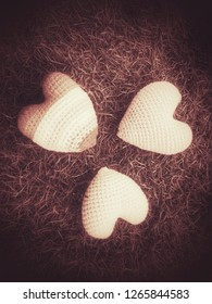 mini hearts made from soft yarn in monochrome pink color for symbol of love in Valentines day, Pink three hearts image