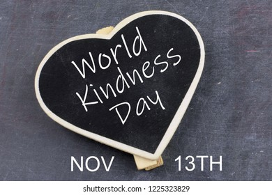 A mini, heart-shaoed backboard on a worn steel background with text added for World Kindness Day on November 13th