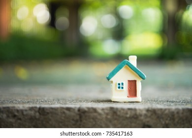Mini house on green nature background