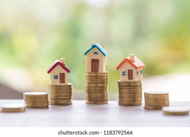 Mini house on stack of coins,Money and house, Real estate investment, Save money with stack coin, Mortgage concept.