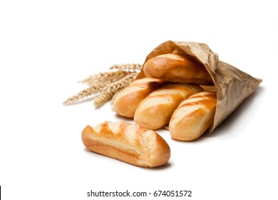 Mini  loaf bread in paper bag and wheat ears isolated on white background