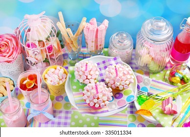 mini marshmallow cupcakes with candles for kid`s birthday party