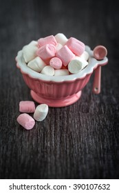 Mini marshmallows in pink bowl with moody feel