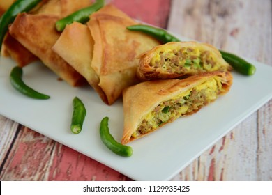 Mini Martabak, a square crepes filled with mixture of egg, green onion and minced beef