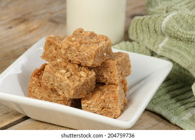 mini oat and syrup flapjacks with a glass of milk