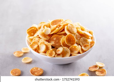 Mini pancake cereal with banana for breakfast. Mini pancake cereal is new trend. Mini pancakes cereal served for breakfast/snack.