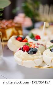 Mini Pavlova dessert on a candy bar, wedding buffet table