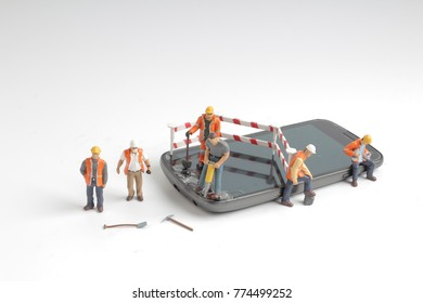 Mini people in engineer or worker occupation isolate