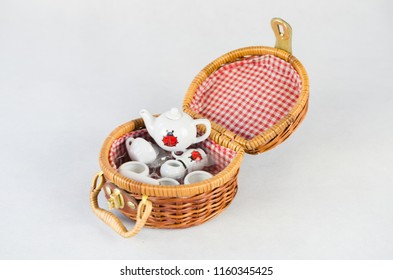 Mini picnic basket with porcelain tea set - children toy isolated