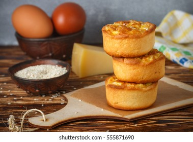 Mini pies with cheese, onion and egg. Tartlets. Delicious snack for gourmands. Selective focus