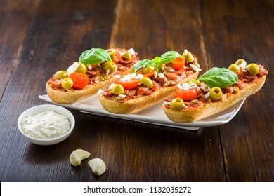 mini pizza and casseroles - tasty snacks with sausage and vegetables