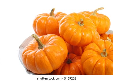 Mini pumpkins stacked in a pie plate