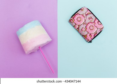 Mini purse with cotton candy on pastel backgrount.