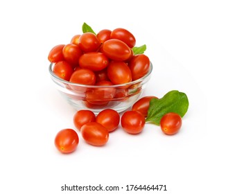 Mini red tomatoes isolated in galss bowl on white