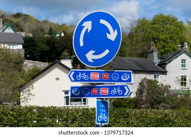 Mini roundabout and cycleway signs at Grange-over-Sands, Cumbria, including signs for the Morecambe Bay Cycle Way