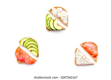 Mini sandwich set with french baguette, cheese, fish and avocado on white background top view mock up