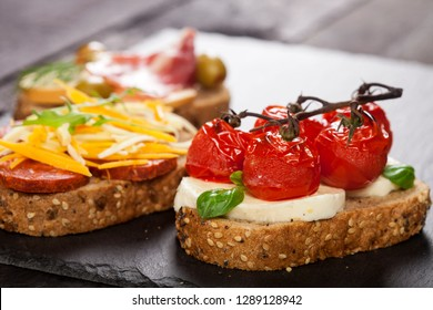 Mini sandwiches food set. Brushetta or authentic traditional spanish tapas for lunch table. Delicious snack, appetizer, antipasti on party or picnic time.